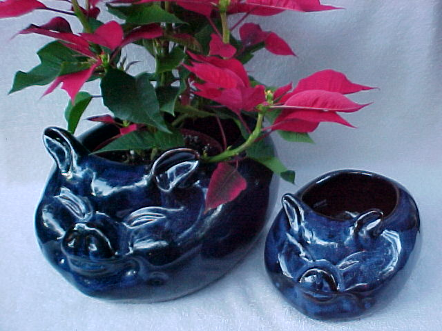 Cobalt Blue in color, these piggy planters come in two sizes. The detail is very good and they would be excellent for home crafting of centerpieces or for holding a decorative plant.